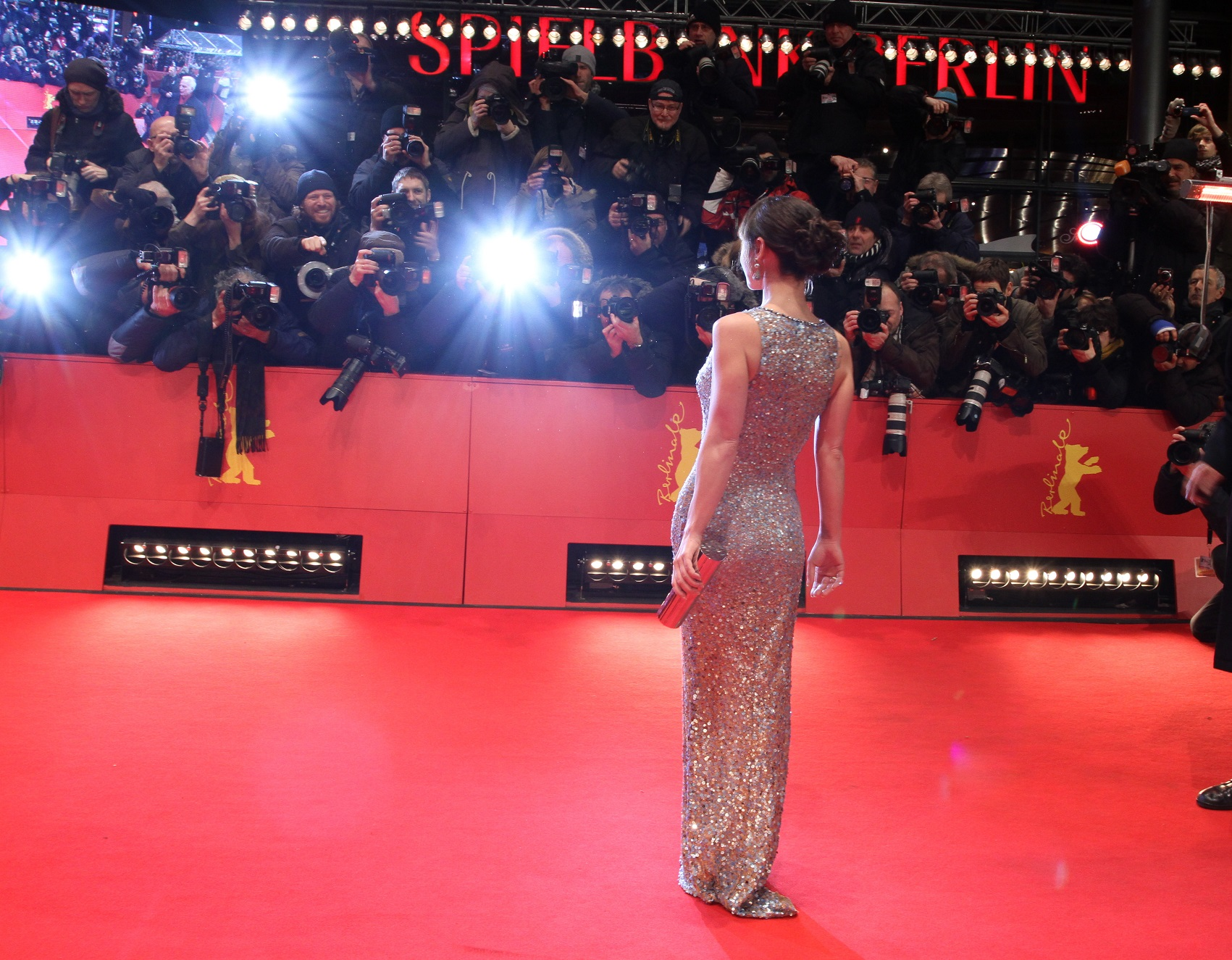 Model getting picture taken on red carpet